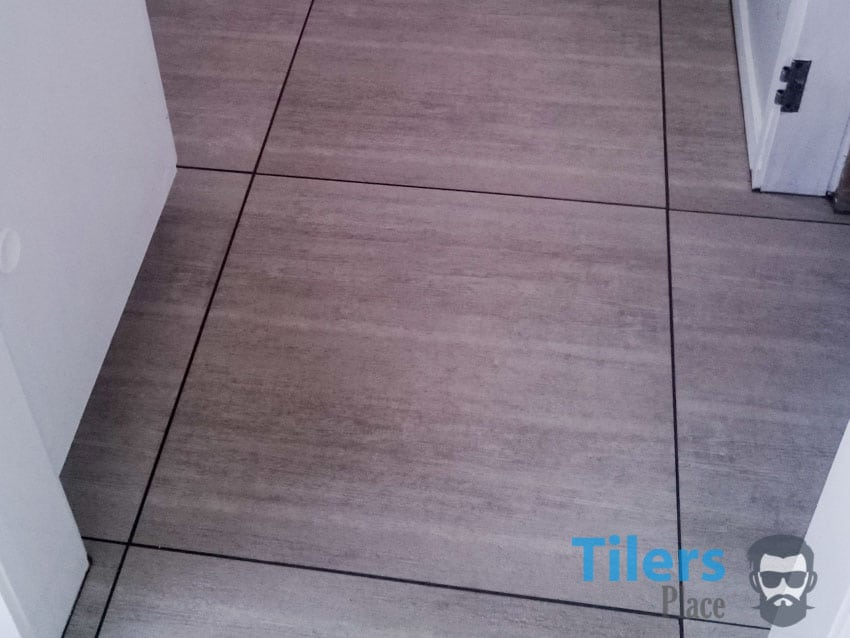 Clean tiled surface without grout haze.