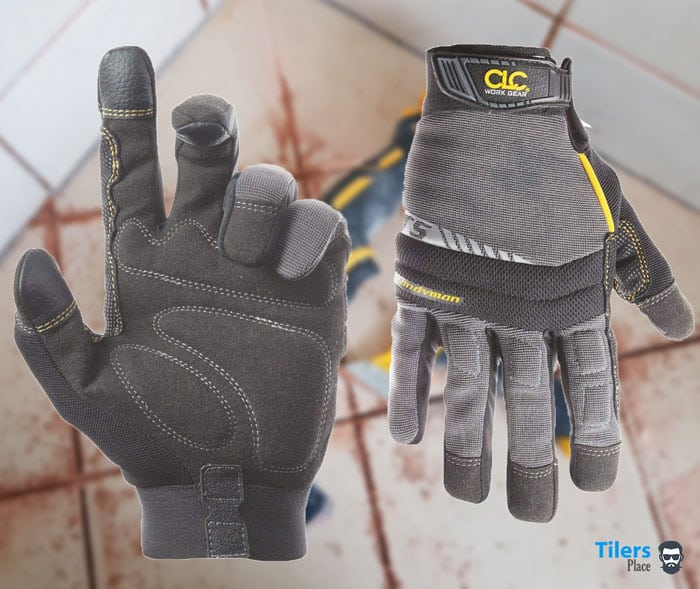 Wearing work gloves is essential for removing grout